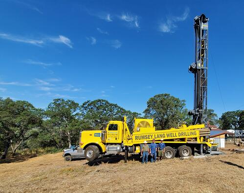 Ramsey-Lang family in front of their new Epiroc TH60 Water Well Drill Rig